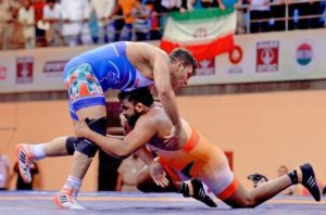 Wrestler Sumit claims gold in men's 125 kg freestyle