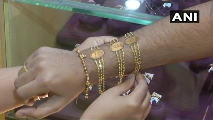 Shop In Gujarat Sells Gold Rakhis At Rs. 50,000 With PM Modi's Pictures On It