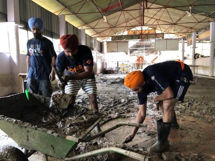 After church, Sikh volunteers from Khalsa Aid take up temple cleaning