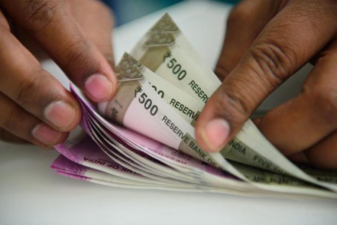 Rupee hits record low of 73.34 a dollar on high global crude oil prices