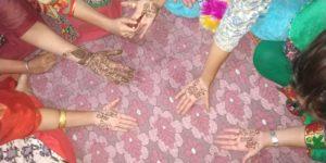 """Punjab Sarkar Murdabad"" written on women teachers hands with henna"