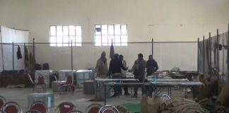 Haryana: JJP workers guard strong rooms in Jind ahead of counting