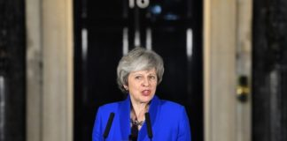 UK PM May narrowly survives no-confidence vote after Brexit defeat; reaches out to rivals