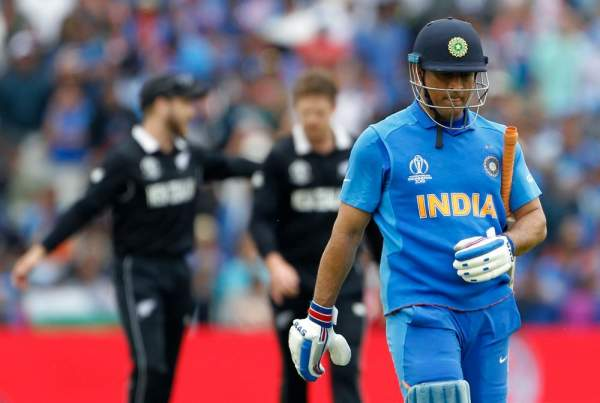 Indian batsman ms dhoni leaves the ground after being dismissed during the semi final match against new zealand