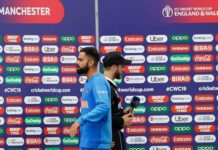 India's captain virat kohli and new zealand's captain kane williamson after the semi-final match between india and new zealand