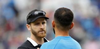 New zealand's captain kane williamson shakes hand with indian captain virat kohli after winning the semi final match against india