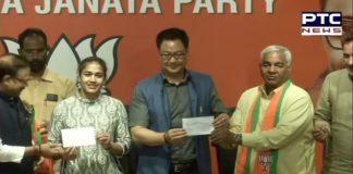 Babita Phogat and her father Mahavir Singh Phogat joins BJP in the presence of Sports Minister Kiren Rijiju