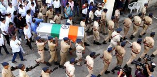 Police carry the mortal remains of music director and background score composer mohammed zahur khayyam during his last rites
