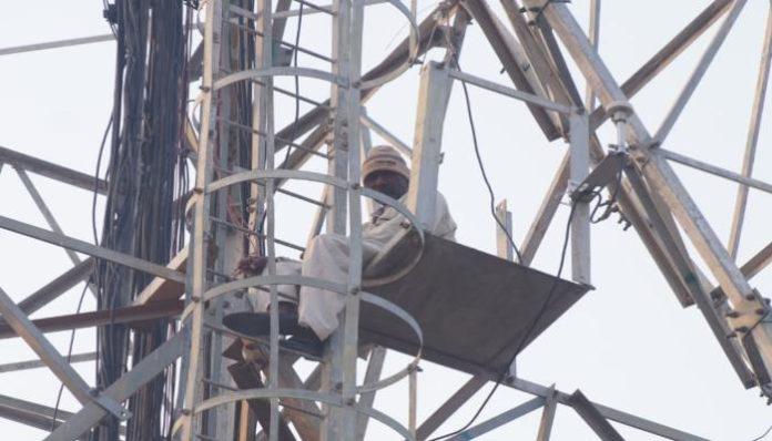 Elderly Man Climbs Tower