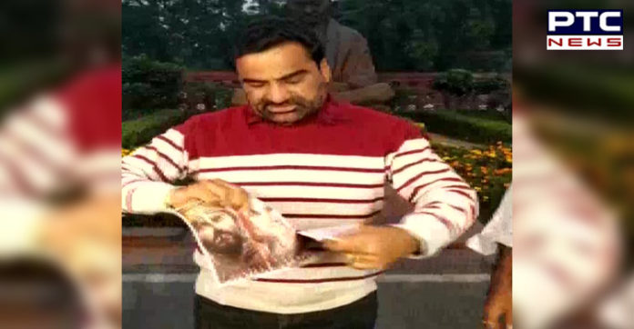 Rajasthan MP Hanuman Beniwal tears the poster of 'Panipat' in protest against the film