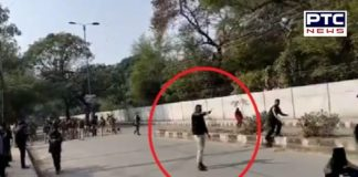 A man brandishes gun in Jamia area of Delhi