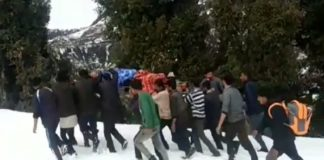 road closed due to snowfall, patient-carried-on-shoulders-to hospital