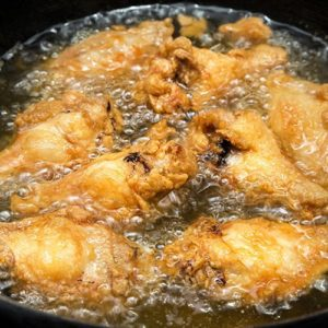 Woman Puts Her Hand in Hot Oil to Fry Food