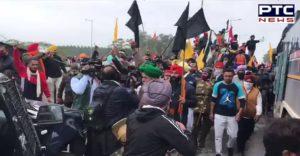 Farmers at Sambhu border dig up Haryana police barricades and throw them into canal