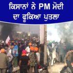 Farmers burn effigies of PM Modi at Delhi's Singhu border