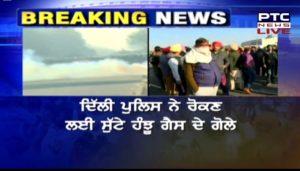 Farmers Protest : Punjab farmers at Delhi border , Police use tear gas shells at Delhi