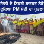 Farmers burn effigies of PM Modi against the Central Government's Farm laws