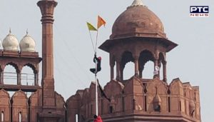Farmers Tractor Parade : Farmers hoist the flag at the Red Fort Delhi