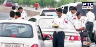 Ghaziabad Police challans a man for not wearing helmet while riding car