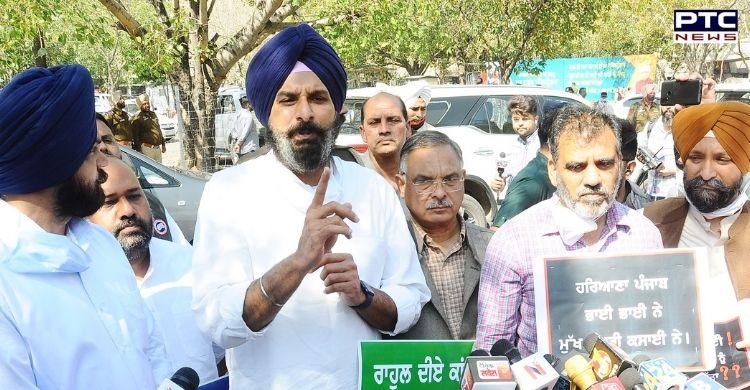 Punjab Budget 2021: Shiromani Akali Dal MLAs including Bikram Singh Majithia protested outside Punjab Vidhan Sabha and distributed 'Meethiyan Goliyan'.