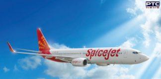 Passenger tries to open emergency door of airborne SpiceJet flight