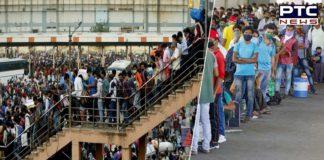 Delhi lockdown: Huge number of migrants queue up at bus stands