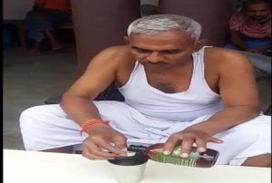 BJP MLA Surendra Singh gives a demonstration of drinking cow urine to keep away COVID-19