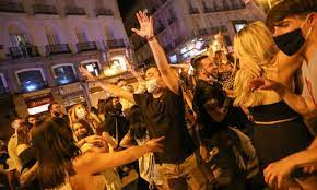 lockdown ends in Spain , youngsters come out on streets to celebrate ,couple kiss photo viral