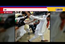 Farmers wear torn clothes of BJP leader Kailash Meghwal