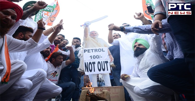 Youth Congress workers carry weapons during protest against fuel prices hike