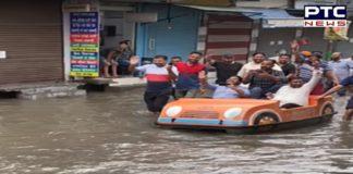 Former Patiala Mayor Kabir Dass takes boat ride on waterlogged streets in Nabha