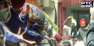 Farmers show black flags to Navjot Singh Sidhu on his arrival in Khatkar Kalan village